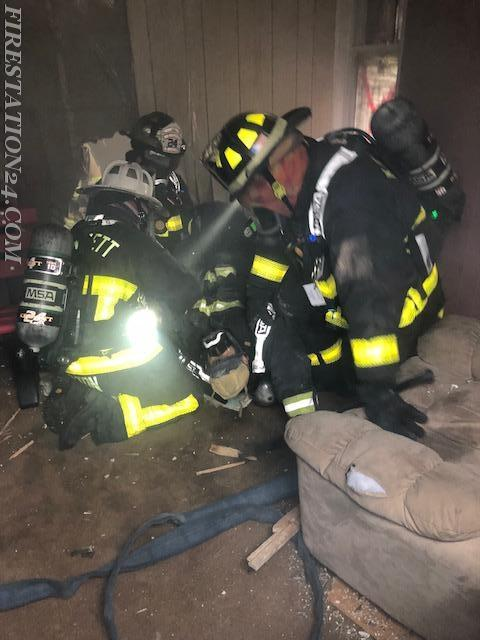 Members dragging a victim (dummy) through a structure